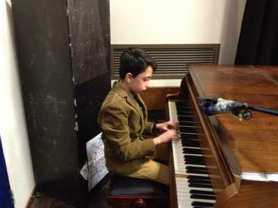 Hadaf Student playing Piano